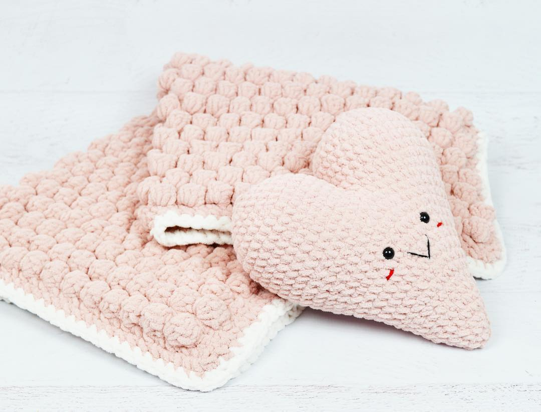 crocheting with this cozy pale pink yarn